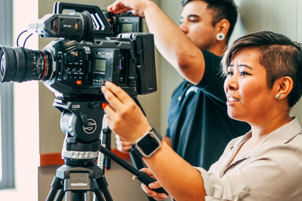 Cal State LA film students working with cameras.