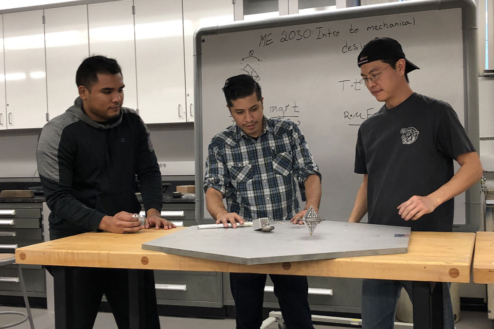 Cal State LA students create a gyroscope for a rotating design project.