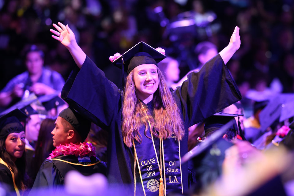 A graduate celebrates at the morning Commencement ceremony.