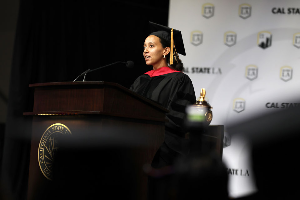 Disability rights advocate Haben Girma addresses graduates in the Charter College of Education at Cal State LA.