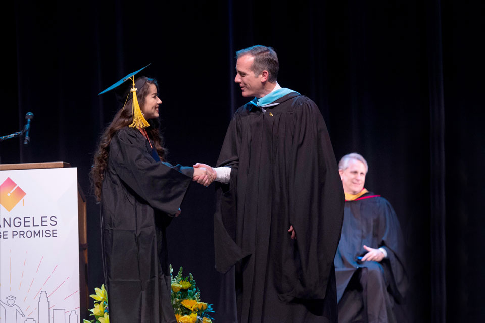 Mayor Garcetti congratulating a College Promise student.