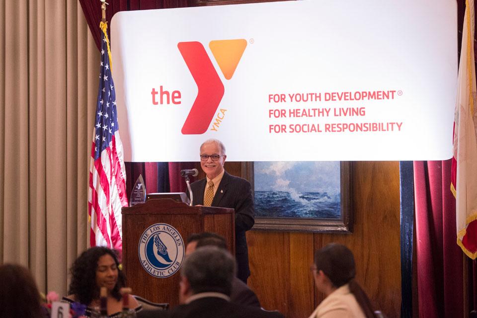 President William A. Covino accepts the award at the Southeast-Rio Vista YMCA gala.