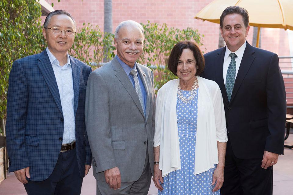Jill Adler Moore with President Covino, Vice President Gomez, and Howard Xu