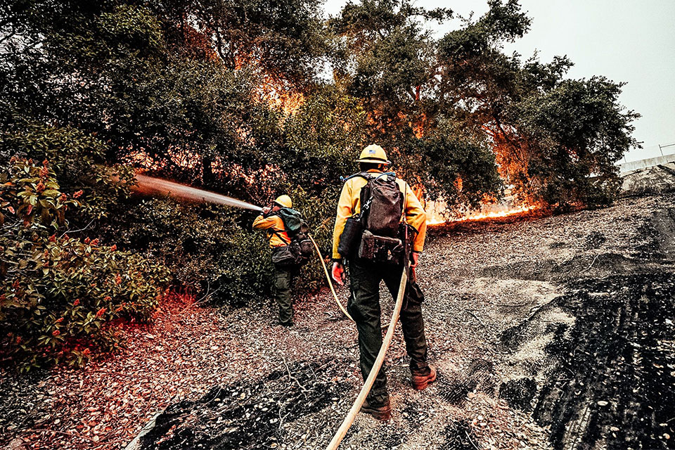 Cal State LA student Hector Banda battles the Bobcat Fire with his U.S. Forest Service crew