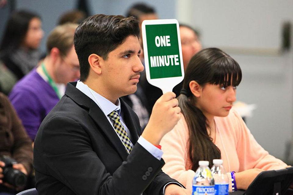 Student timekeeper for the debates.