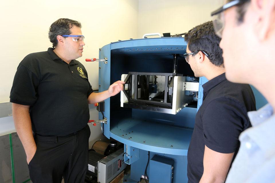 Professor Gustavo Menezes, the grant's lead principal investigator, teaching students in a civil engineering class