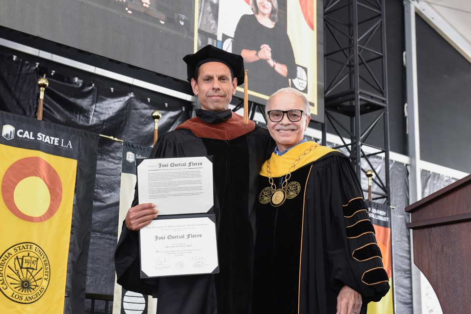 Honorary doctorate recipient, José Quetzal Flores and Cal State LA President, William A. Covino