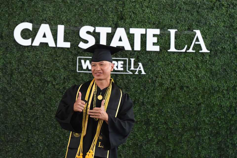 Formerly incarcerated students from Cal State LA's groundbreaking prison education program walk at Commencement
