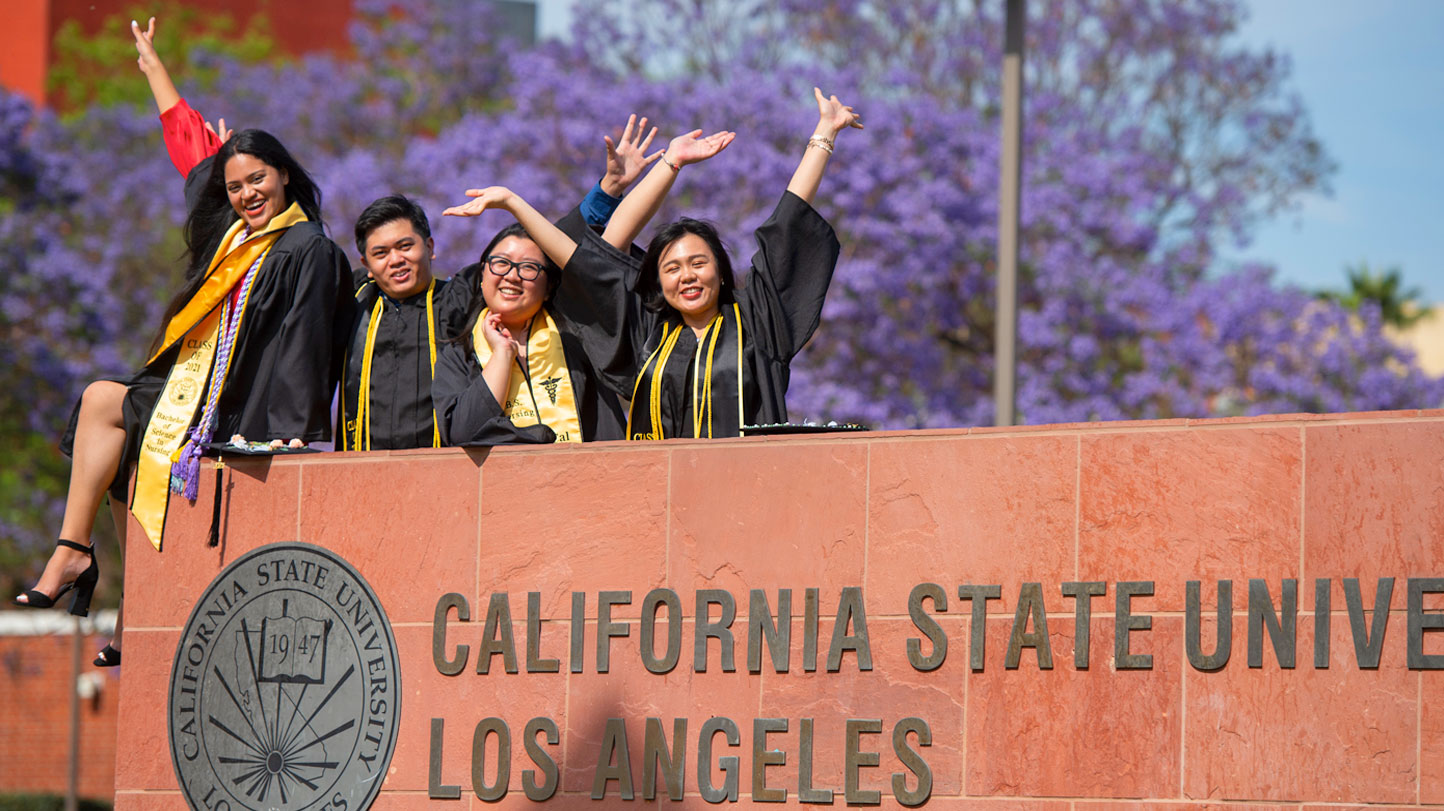 Class of 2021 graduates mark their accomplishments with photos around campus.