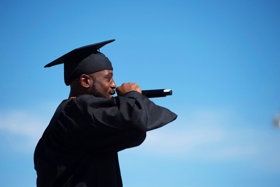 Graduate Samuel Nathaniel Brown performs during the commencement ceremony at California State Prison, Los Angeles County.
