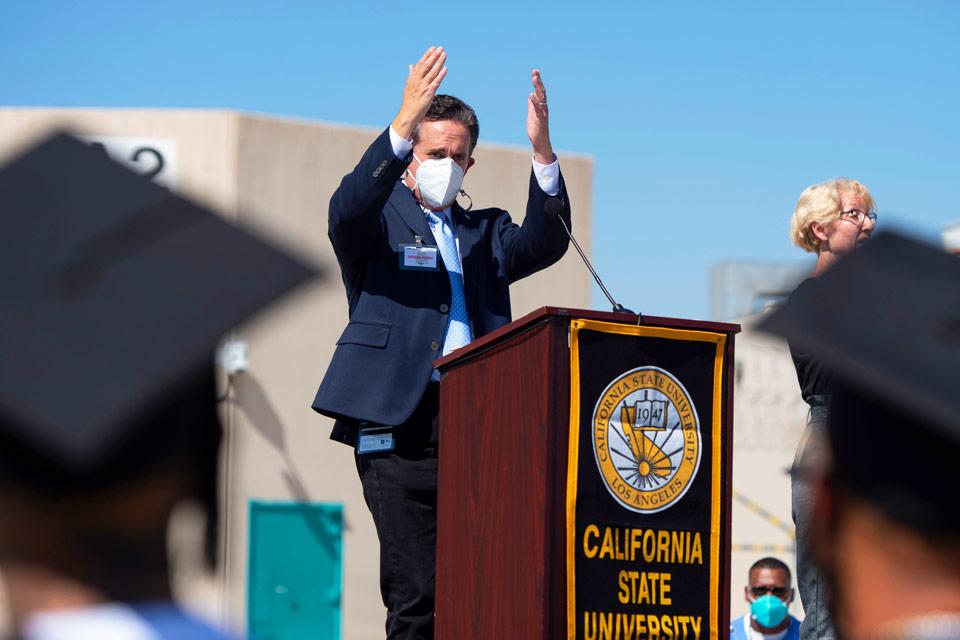 Cal State LA Provost and Executive Vice President Jose A. Gomez congratulates the graduates.